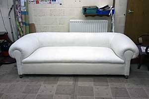 The same Chesterfield with calico lining ready for loose covers.